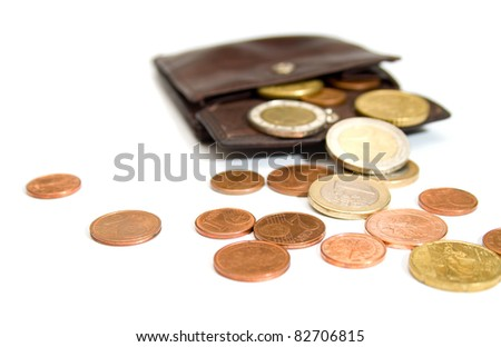 Euro coins spilling out of open leather wallet - stock photo