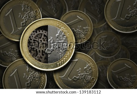 Euro coins with gears inside - stock photo