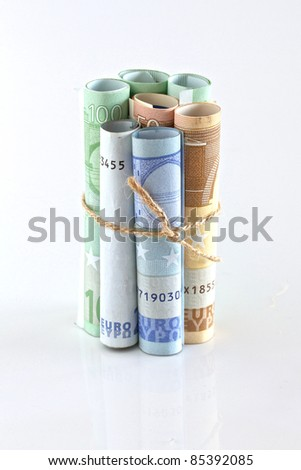 Euro crisis.Euro bills rolled up and tied with string and isolated. Money is tied up or tight concept - stock photo