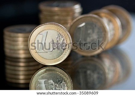 Euro currency. Several 1 Euro coins. - stock photo