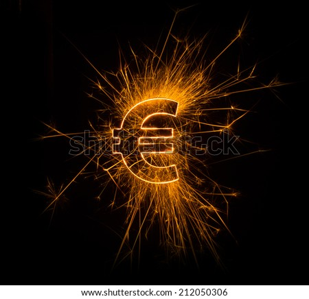 Euro dollar sign in bright sparkly fire on black background - stock photo