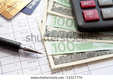 euro, dollars,  calculator and financial documents. closeup.