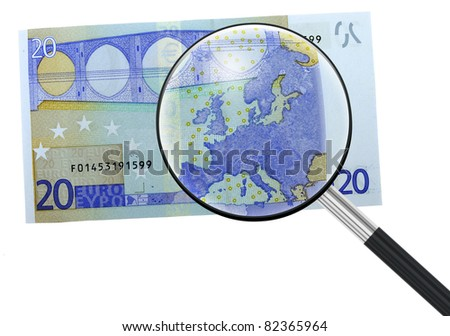 Euro, Europe under magnifying glass - crisis, recession metaphor - stock photo