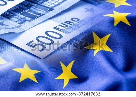 Euro flag. Euro money. Euro currency. Colorful waving european union flag on a euro money background. - stock photo