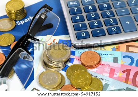 Euro money and calculator on a bankbook - stock photo