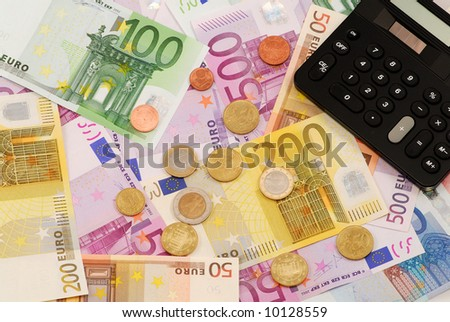 Euro money background with notes, coins and calculator