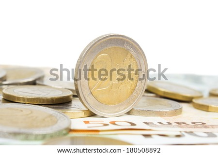 euro money banknotes with 2 euro coins - stock photo
