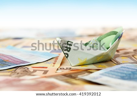 euro money boat on banknotes. abstract money concept - stock photo