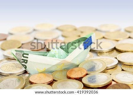 euro money boat on coins, abstract money concept - stock photo
