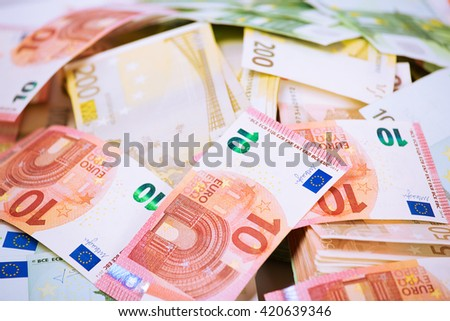 Euro. Money. Closeup cropped image macro photo of European union currency bills, euro banknotes stack, pile.  Financial reward, savings, lottery win, payment, bank account concept. Finances, liquidity - stock photo