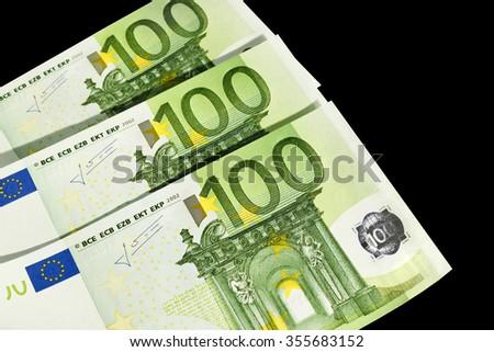 Euro money on black background - stock photo