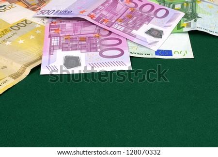 Euro money on green cloth - stock photo