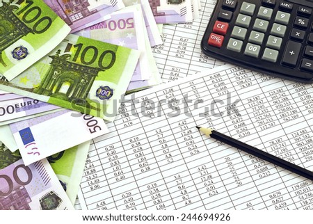 Euro money with calculator and financial tables with numbers - stock photo