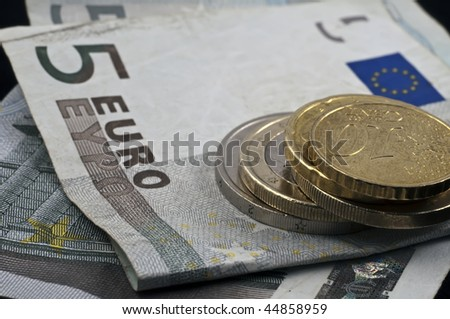 Euro money with coins and bills - stock photo
