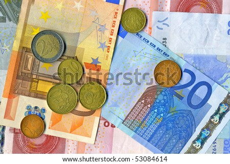 Euro notes and euro cents - stock photo