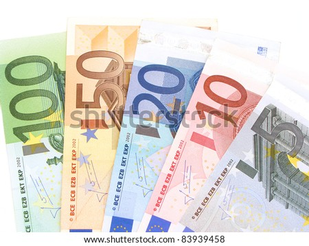 Euro notes arranged in a fan on a white background - stock photo