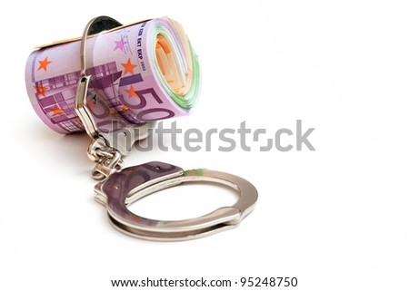 Euro notes with a pair of handcuffs - stock photo