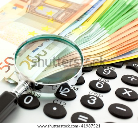 Euro Notes with calculator and magnifier. Closeup - stock photo
