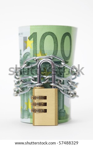 Euro notes with lock and chain - stock photo
