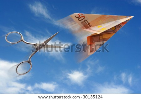 euro plane and scissors on blue background - stock photo