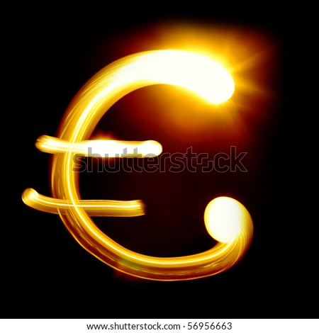 Euro sign created by light over black background - stock photo