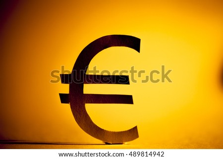 Euro symbol made form paper. Money concept. Selective focus.