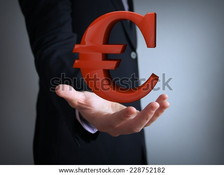 euro symbol over businessman hand