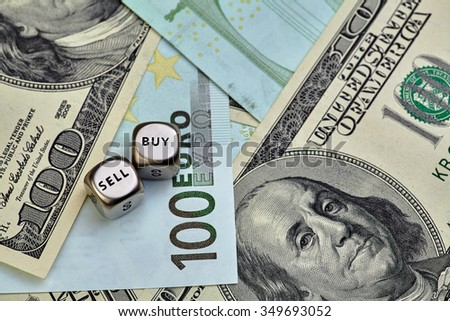 EURO, USD banknotes and dices cubes. Selective focus - stock photo