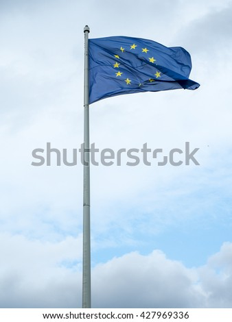 Europe flag waving against cloudy sky