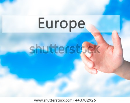 Europe - Hand pressing a button on blurred background concept . Business, technology, internet concept. Stock Photo