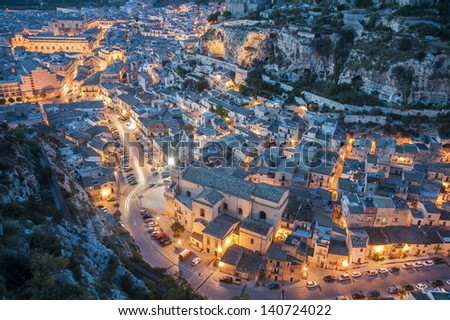 europe, italy, sicily, scicli, urban landscape at sunset - stock photo