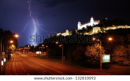 Europe, Slovakia, Bratislava, evening, night, rain, lightning, thunder, sky, glow, flash, electric shock, electricity, night city lights, street, avenue, bad weather, castle, fortress, tower, rock, - stock photo