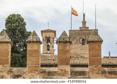 Europe, Spain, Balearic Islands, Mallorca, Palma de Mallorca.  La Seu, Mallorca Cathedral. Gothic.  flag and wall. - stock photo