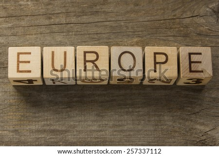 Europe text on a wooden background - stock photo