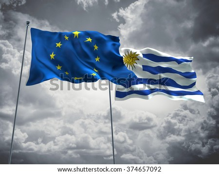 Europe Union & Uruguay Flags are waving in the sky with dark clouds