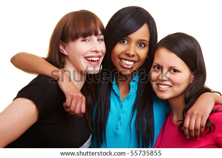 European, African and Asian women smiling together - stock photo