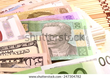 european and american money, dollars, euro and hryvnia - stock photo