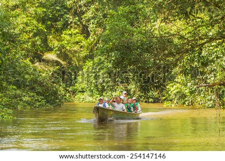 European Biologists In The Canoe Crossing Cuyabeno River, South America