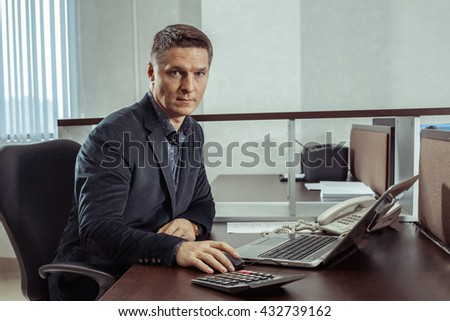 European businessman works in the office.