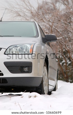 European car parked in snow - stock photo