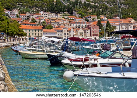 European City Scape. Bay, Boat, Mountain, Sea and Sky. Hvar. Croatia. High quality stock photo.