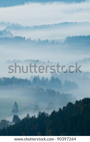 European countryside during the misty sunrise. - stock photo