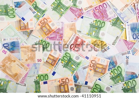 European currency banknotes scattered on the table, top view - background