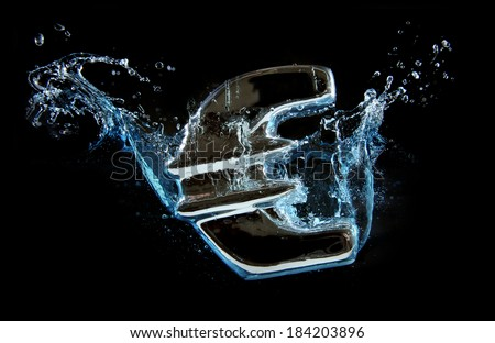 European currency Euro sign splash into water in business , recession , Europe crisis ,  economy crunch and  financial concept  - stock photo