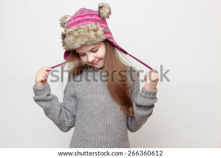 European fashion little girl wearing jeans and sweater - stock photo