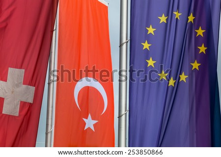 european flag and other flags, symbols for eu membership for turkey - stock photo