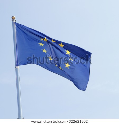 European flag waving in the mast with blue sky background - stock photo