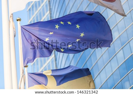 European Flag with Modern Skyscrapers - stock photo