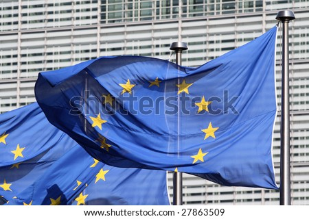 European flags floating in front of the European Commission Building in Brussels, wind blowing from the right - stock photo