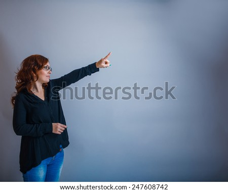 European - looking  woman  of  thirty  years  is pointing in the  direction of